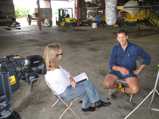 Landline journalist Pip Courtney interviews cane grower Mario Racanello about the Reef Rescue initiatives on his Tully farm.