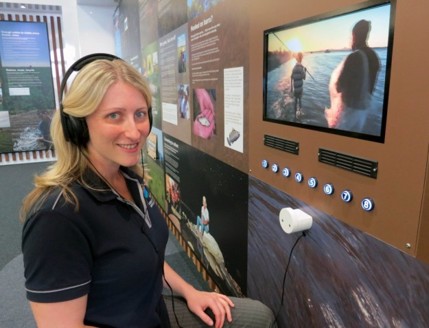 Caption: Traditional Ecological Knowledge Project Officer Cassandra Bouna viewing the videos in Fitzroy Basin Association's FLOW Visitors Centre
