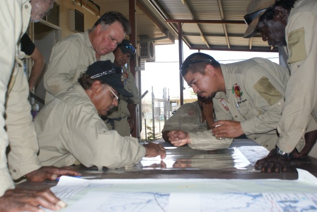 Rangers adding their combined knowledge to compile cultural and environmental information to the map overlays