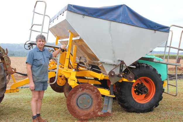 Innisfail cane grower Joe Zappala and his stool splitter and fertiliser box modified to cope with his sticky red soil